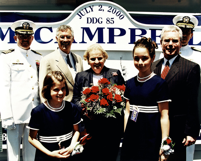 The christening party for the USS MCCAMPBELL (DDG 85) is from left to right, Captain R. Hepburn, USN, Hon. Richard Danzig, Secretary of the Navy, Hon. Madeline K. Albright, Secretary of State and Ship's sponsor, Mr. Allen Cameron, President and CEO of Bath Iron Works, Rear Admiral Michael M. Mullen, USN. In the foreground are the Maids of Honor, Miss Levesque and Miss Moore