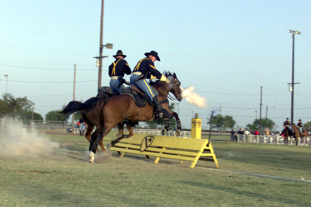 During Freedom Fest 2000, members of the 1ST Cavalry Division, Horse Detachment, demonstrate a mounted assault while firing blanks at a gallop