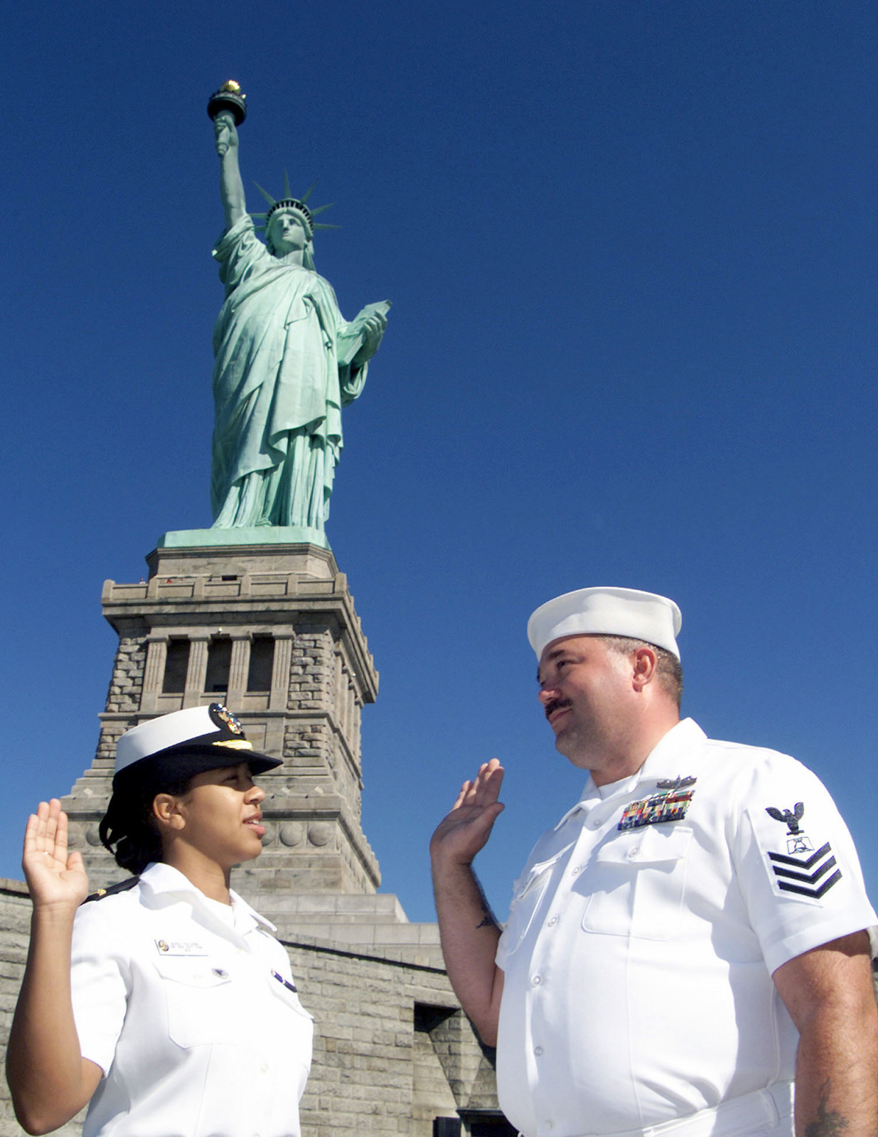 ENSIGN (ENS) Maria Navarro assigned to the USS HUE CITY (CG 66), re-enlists her shipmate Mess SPECIALIST 1ST Class (MS1) John Carruthers in a special ceremony on Liberty Island, New York