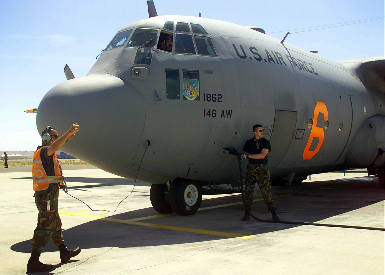 US Air Force (USAF) Airmen assigned to the 146th Airlift Wing (AW), California (CA) Air National Guard Station, prepare to launch their Modular Airborne Fire Fighting System (MAFFS) C-130 Hercules aircraft for another firefighting mission in support of the National Interagency Fire Center in Boise, Idaho