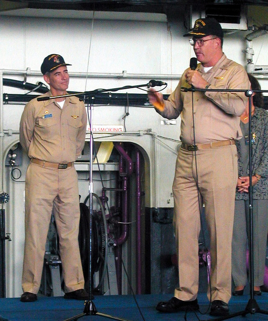 Captain (CAPT) Tom Parker, Commanding Officer of USS BELLEAU WOOD (LHA 3) (right), emphasizes the importance of safety to the crews of his ship, while CAPT Robert J. Gilman, Commanding Officer of the USS ESSEX (LHD 2) listens