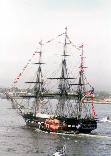 USS CONSTITUTION (Old Ironsides) returns to port after leading the tall ships out of the Boston Harbor during the Sail Boston 2000 event