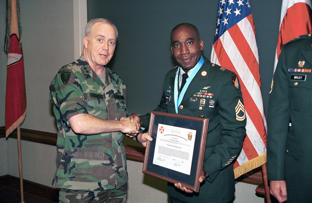 Major General Barry D. Bates, Commanding General of the 19th Theater Support Command (TSC), inducts SPECIALIST First Class Carlton Lumbley, Delta Troop 1/6 Cavalry, into the Audie Murphy Club at a ceremony held at Taegu, South Korea