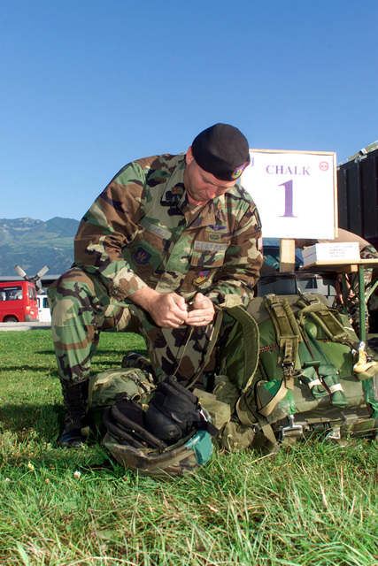 Straight on medium close-up shot as US Air Force Major Jeffrey W. Kelly from detachment 1, 4th Air Special Operation Group, prepares his gear for Operation Rapid Resolve II, a show of force exersise in Bosnia, 17Jul00
