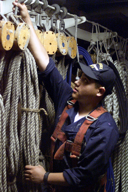 SEAMAN (SN) Israel Perez of El Paso, Texas, secures lines in the riggers loft aboard the landing helicopter dock ship USS ESSEX (LHD 2)