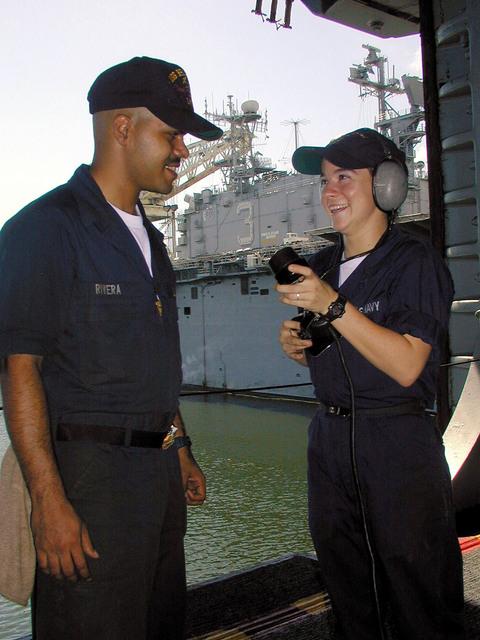 USS ESSEX (LHD 2) sailor SEAMAN Kristen Hancock from Batson, Texas discusses communication procedures with USS BELLEAU WOOD (LHA 3) crewman Aviation Structural Mechanic AIRMAN (AMN) Edwin Rivera from Vegabaja, Puerto Rico during damage control training in Repair Locker #3