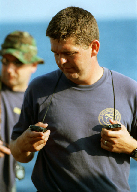 MASTER CHIEF Engineman (ENC) David Davidson stationed at Naval Sea Systems Command (NSSC) checks his watches while supervising a dive on the wreck of the USS MONITOR, off Cape Hatteras