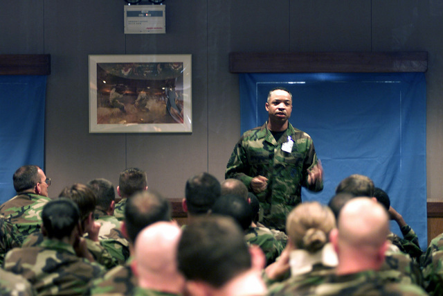 Straight on medium shot as the US Air Force's 16th Air Force Command CHIEF MASTER Sergeant David Mimms answers questions at an Enlisted Call at Araxos Air Base, Greece. AIRMAN of the 731st Munitions Support Squadron had the opportunity to ask questions and give feedback to CHIEF Mimms concerning morale improvements on the base such as the new dormitories (Not shown) that were opened earlier this year