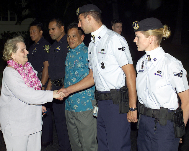 Right side profile medium shot as US Secretary of State, Madeleine Albright, shakes hands with AIRMAN Christopher Michaels, 15 Security Forces Squadron (15 SFS) and AIRMAN First Class Jill L. Bowyer, 15 SFS, as she departs Hickam Air Force Base, Hawaii on July 26th, 2000. Secretary Albright is en route to the AESAEN Political Forum in Bangkok, Thailand