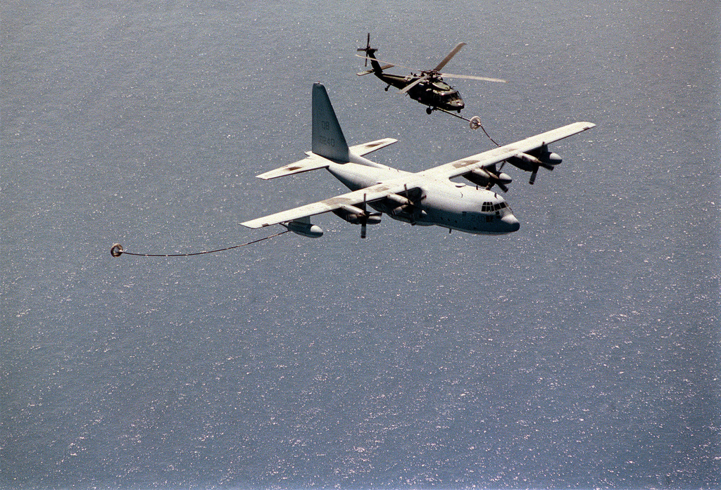 A KC-130 Marine Air Refueler from 252nd Transport Squadron, Marine Corps Air Station Cherry Point, North Carolina, refuels a USAF HH-60 Pave Hawk helicopter from the 66th Expeditionary Rescue Squadron, Nellis Air Force Base, Nevada, over the Mediterranean Sea. The units are deployed to Incirlik Air Base, Turkey, in support of Operation NORTHERN WATCH, enforcing the no-fly zone over Iraq