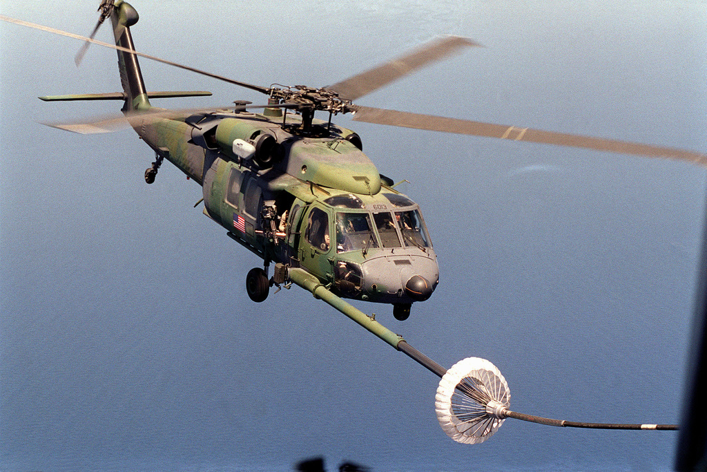 A US Air Force HH-60 Pave Hawk helicopter, from the 66th Expeditionary Rescue Squadron, Nellis Air Force Base, Nevada, practices refueling over the Mediterranean Sea. The unit is deployed to Incirlik Air Base, Turkey, in support of Operation NORTHERN WATCH, enforcing the no-fly zone over Iraq