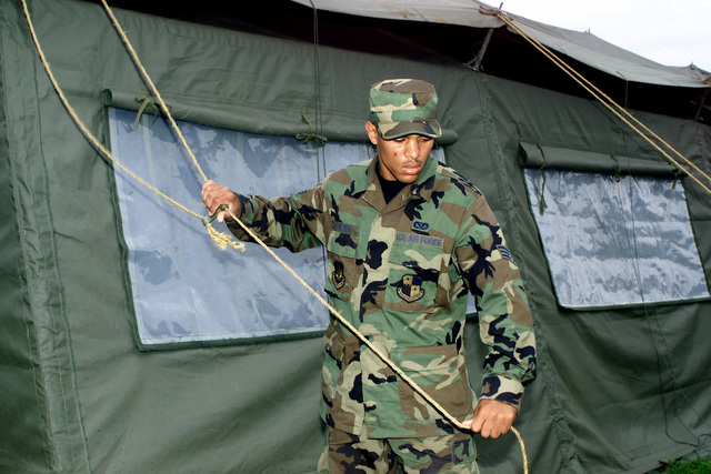 US Air Force SENIOR AIRMAN Tavares Lumpkin, 52nd Civil Engineer Squadron, Spangdahlem, Air Base, Germany, breaks down a tent at 33rd Kuchyna Air Force Base, Malacky, Slovakia. Nearly 200 people and eight A-10's from Spangdahlem AB, DEU, are deployed to Slovakia for a two-week training exercise, which allowed US and Slovak Air Forces an opportunity to share tactics, techniques and procedures