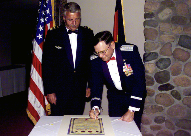 US Air Force General John Jumper (Right), Air Combat Command Commander, and Lieutenant General Peter Vogler, German Air Force Command Commander, sign the Decree of Honor cementing the relationship between the 63rd Fighter Squadron, Luke Air Force Base, Arizona, and the Luftwaffe's Cactus Starfighter Squadron, also stationed at Luke, AFB, during Class 00-IBG graduation