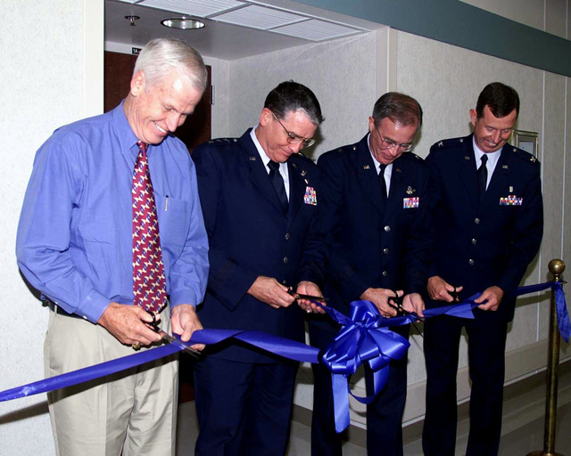 (left to right) Texas Congressman Charlie Stenholm, Lieutenant General Carlton, General Stein, and Colonel Raynaud cut the ribbon at the new addition to the Hospital at Dyess Air Force Base, Texas