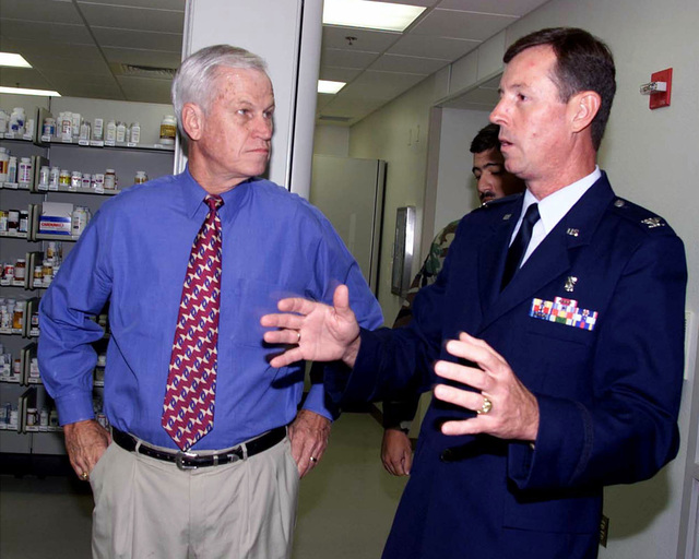 US Air Force Colonel Raynaud (right) and Texas Congressman Charlie Stenholm stop in at the pharmacy on their tour of the Dyess Air Force Base, Texas, Medical Group