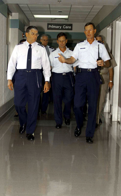 US Air Force Lieutenant General Carlton (left), USAF Brigadier General Taylor (center), and USAF Colonel Raynaud (right) take a tour of the Dyess Air Force Base, Texas, Medical Group