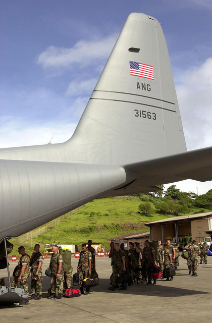8th Engineer Support Battalion Marines, Camp Lejeune, North Carolina, load up for their flight aboard a 156th Airlift Squadron, North Carolina Air National Guard C-130 departing from Point Salines, Grenada, to Roosevelt Roads Naval Air Station, Puerto Rico, on August 7th, 2000. The Marines just finished a three month deployment as part of Joint Task Force Midas. The Air Force's 820th RED HORSE Squadron, Nellis Air Force Base, Nevada (Not shown), and the Marine's 8th Engineer Support Battalion, Camp Lejeune N.C., are part of a larger humanitarian exercise sponsored by USSOUTHCOM (United States Southern Command) and is tasked with constructing a community center, barracks, and a school...