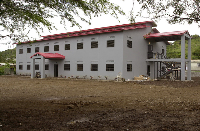 A front view of the competed Frequente School building constructed primarily by U.S. Air Force members, 820th RED HORSE, Nellis Air Force Base, Nevada on August 7th, 2000. The Air Force's 820th RED HORSE and the Marine's 8th Engineer Support Battalion, Camp Lejeune, North Carolina (Air Force and Marine members not shown), are part of a larger humanitarian exercise sponsored by USSOUTHCOM (United States Southern Command) and is tasked with constructing a community center, barracks, and a school. This exercise, New Horizons 2000, is held in various Caribbean and South American locations