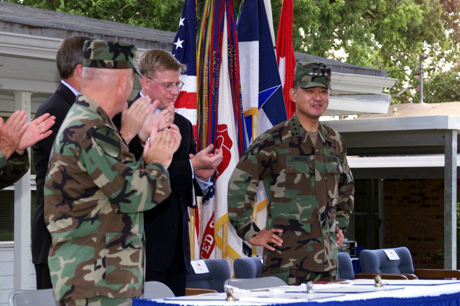 General Eric K. Shinseki, CHIEF of STAFF, US Army, is warmly greeted during the official Partnership Declaration Residential Communities Initiative signing ceremony. The landmark ceremony took place symbolically under a large Texas live oak in front of residential housing Building 5721-2, Fort Hood, Texas on 8 August 2000