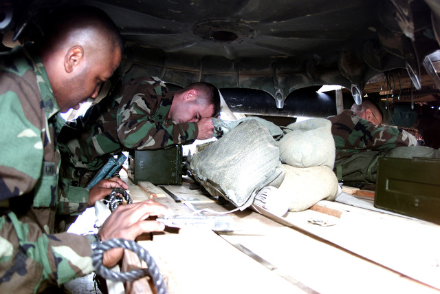 Medium shot, soldiers of the 173rd Airborne Brigade, 1/508th Infantry (Airborne Battalion Combat Team), from Vicenza, Italy, secure fuses to a 105mm howitzer pallet. Not shown: Howitzer is to be dropped at Bunker Hill Drop Zone, Grafenwohr, Germany, by the 37th Airlift Squadron, Ramstein Air Base, Germany, in Exercise Lion Drop 12, 9 August 2000