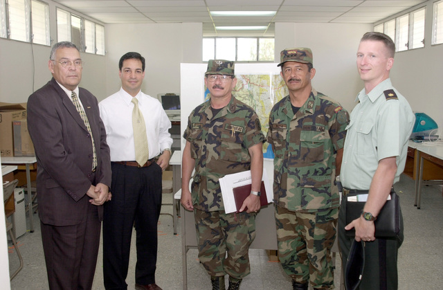 Left to right, Honduras Vice Minister of Defense, General Rosales Avella; Hector Lopez, US Army South MSEL Manager; Honduran Colonel Roque Arias Zavala, CHIEF Exercise Control Group; Honduran Colonel Willy Nelson Mejia, Director National Military Academy; Major Timothy Hodge Operations Officer, USARSO, pose during Peace Keeping Operation (PKO) NORTH 2000, Honduras Central America. PKO North 2000, 14-25 Aug 2000, was hosted by the governments of Honduras and the United States, and held at the National Military Academy, Tegucigalpa, Honduras