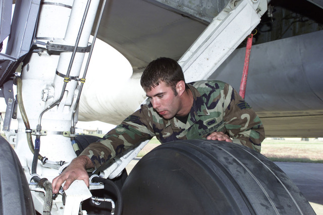 US Air Force SENIOR AIRMAN Eric Hunt, a crew chief for the 22nd Expeditionary Refueling Squadron, McConnell Air Force Base, Kansas, performs routine checks of the KC-135 here at Operation Northern Watch, Incirlik Air Base, Turkey