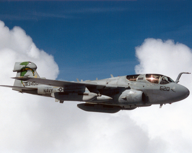"""000814-N-0000X-006On Board USS Harry S. Truman (CVN 75)A EA-6B Prowler from Tactical Electronic Warfare Squadron One Three Zero (VAQ-130), """"Zappers"""", surveillances the area during COMTUEX, Comprehensive Training Unit Exercise, while stationed on board USS Harry S. Truman (CVN 75). COMTUEX is designed to bring the aircraft carrier/carrier air wing team together as a cohesive fighting unit while giving the team """"blue water"""" certification for operating at sea"""