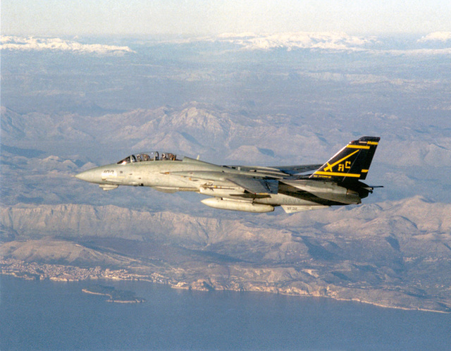 """A F-14 Tomcat from Fighter Squadron Thirty-Two (VF-32), """"Swordsmen"""", takes to flight during COMTUEX, Comprehensive Training Unit Exercise, while stationed on board USS Harry S. Truman (CVN 75). COMTUEX is designed to bring the aircraft carrier/carrier air wing team together as a cohesive fighting unit while giving the team """"blue water"""" certification for operating at sea"""