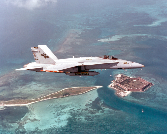 """A F/A-18 Hornet, from Strike Fighter Squadron One Zero Five (VFA-105), """"Gunslingers"""", takes to flight over the Caribbean Sea during COMTUEX, Comprehensive Training Unit Exercise, while stationed on board USS Harry S. Truman (CVN 75). COMTUEX is designed to bring the aircraft carrier/carrier air wing team together as a cohesive fighting unit while giving the team """"blue water"""" certification for operating at sea"""