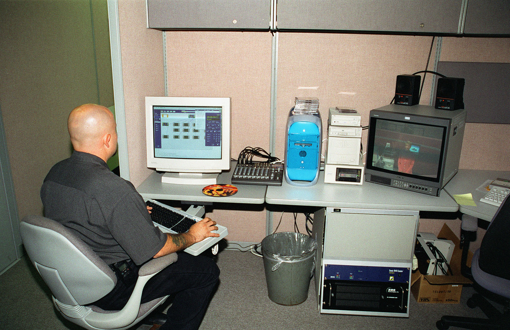Department of the Army Civilian CHristopher Salazar sits at the Sonic Solutions, DVD Creator Authoring Workstation. The system is used for encoding and authoring DVD-R. This piece of equipment is being used in the Fort Sam Houston Audio/Visual Production Facility at Fort Sam Houston, San Antonio, Texas