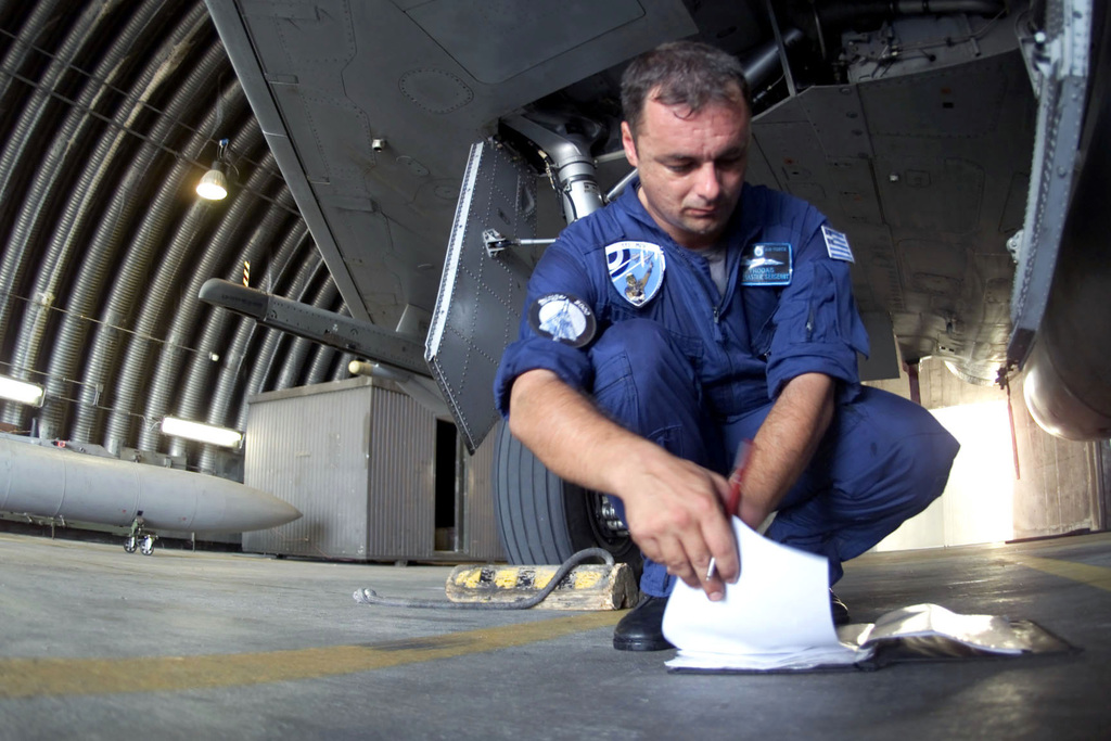 Italian CHIEF MASTER Segeant A. Thodas, an Aircraft Technician with the 114th Composite Group, 331st Tactical Fighter Wing, Hellenic Air Force, Greece, finishes a post-flight check of a Mirage 2000 Fighter. The Hellenic unit is at Aviano Air Base, Italy, to train with the 510th Fighter Squadron. The Mirages provide valuable dissimilar training allowing 510th Fighter pilots the opportunity to train against other types of aircraft