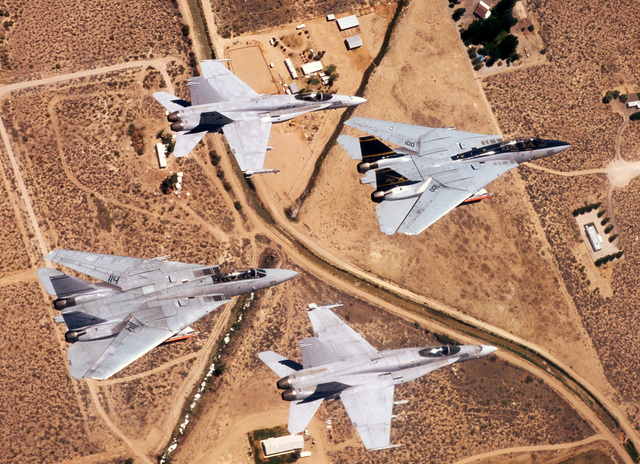 """Two F-14 Tomcats from Fighter Squadron Thirty-Two (VF-32), """"Swordsmen"""", and two F/A-18 Hornets from Strike Fighter Squadron Thirty-Seven (VFA-37), """"Bulls"""", fly in formation during COMTUEX, Comprehensive Training Unit Exercise, while stationed on board USS Harry S. Truman (CVN 75). COMTUEX is designed to bring the aircraft carrier/carrier air wing team together as a cohesive fighting unit while giving the team """"blue water"""" certification for operating at sea"""