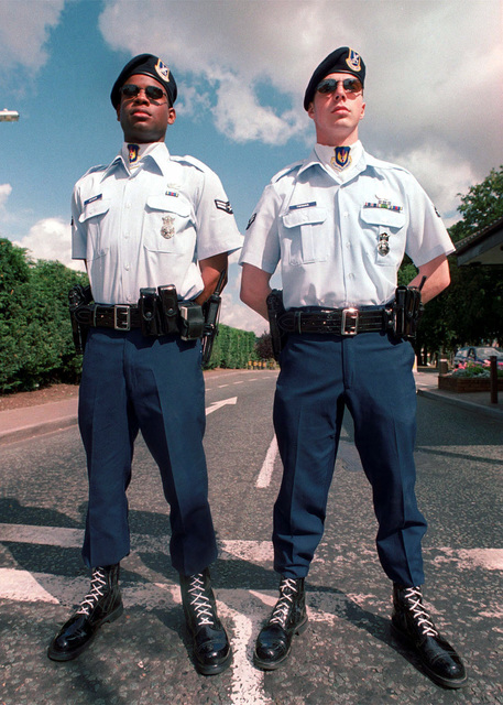 AIRMAN First Class Arlan Aurther (left) and Micheal Twinning of the 48th Security Forces Squadron, 48th Fighter Wing, Royal Air Force Lakenheath, United Kingdom, proudly wear the Air Force blue uniform. Air Force bases in Europe are changing local uniform policies in be in line with United State Air Forces in Europe headquarters uniform policies. Duplicate image, see also DF-SD-01-01769 or search 000816-F-4177H-006)