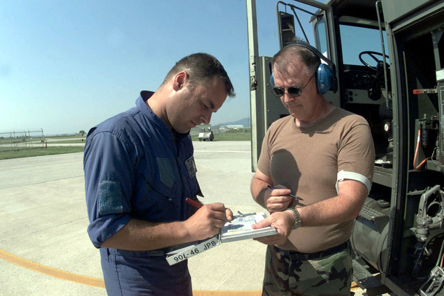 CHIEF MASTER Sergeant A. Thodas, aircraft mechanic from the Hellinic Air Force, 114th Composite Group, 331st Tactical Fighter Wing, Greece, signs for fuel recieved from Technical Sergeant Cal Garlock of the 124th Logistics Squadron, Air National Guard from Idaho, supporting the 31st Supply Squadron. The Hellinic unit is at Aviano Air Base, to train with the 510th Fighter Squadron. The Mirages provide valuable dissimilar training allowing 510th Fighter pilots the opportunity to train against other types of aircraft. (Duplicate image, see also DF-SD-01-01810 or search 000816-F-4728F-008)
