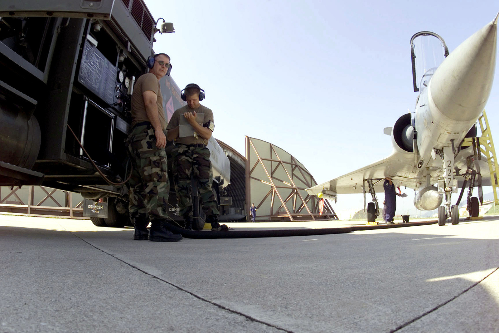 Closest to camera, from left to right, SENIOR AIRMAN William Watros, a Fuels journeyman and Technical Sergeant Cal Garlock of the 124th Logistics Squadron, Air National Guard from Idaho, oversee the re-fueling operation of a Hellenic Mirage 2000. The Hellenic (Greek) unit is at Aviano Air Base, to train with the 510th Fighter Squadron. The Mirages provide valuable dissimilar training allowing 510th Fighter pilots the opportunity to train against other types of aircraft. (Duplicate image, see also DF-SD-01-06171 or search 000816-F-4728F-010)
