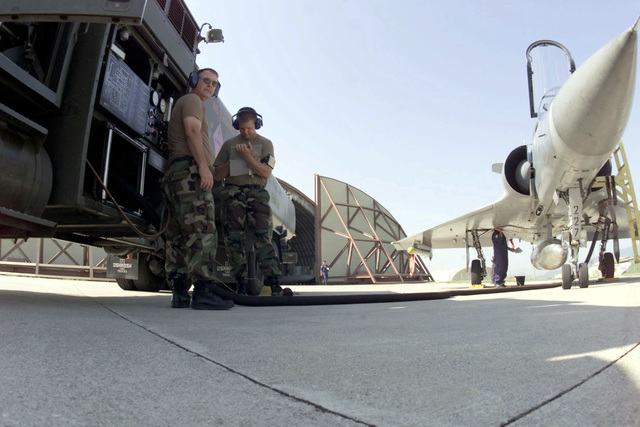 From left to right, SENIOR AIRMAN William Watros, Fuels Journeyman and Technical Sergeant Cal Garlock both from the 124th Logistics Squadron, Air National Guard Idaho, oversee the re-fuelling operation of a Hellenic Mirage 2000. The Hellinic unit is at Aviano Air Base to train with the 510th Fighter Squadron. The Mirages provide valuable dissimilar training allowing 510th Fighter pilots the opportunity to train against other types of aircraft. (Duplicate image, see also DF-SD-01-01811 or search 000816-F-4728F-010)