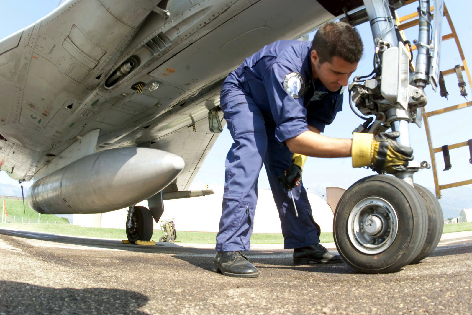 MASTER Sergeant Spyros Siakoulas, aircraft mechanic from the Hellinic Air Force, 114th Composite Group, 331st Tactical Fighter Wing, Greece, performs a post-flight inspection of the nose-gear oleo strut of a Mirage 2000 Fighter. The Hellinic unit is at Aviano Air Base, to train with the 510th Fighter Squadron. The Mirages provide valuable dissimilar training allowing 510th Fighter pilots the opportunity to train against other types of aircraft. (Duplicate image, see also DF-SD-01-01807 or search 000816-F-4728F-005)