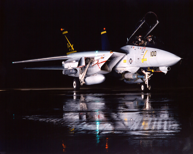 Two pilots sit ready for flight in an F-14 Tomcat aircraft from Fighter Squadron Thirty-Two (VF-32) aboard USS HARRY S. TRUMAN (CVN 75)