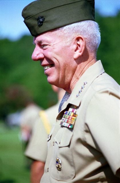 Assistant Commandant of the United States Marine Corps General Dake laughs with guest at the Marine Corps Combat Development Command Change of Command where Lieutentant General John Rhodes relenquished his command to Lieutentant General Knutson at Lejuene Hall, MCB Quantico, Virginia on August 17. 2000