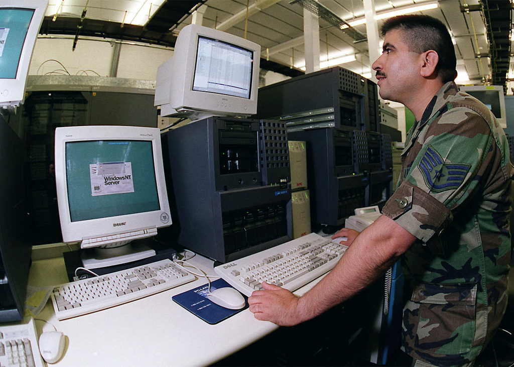 Left side profile medium shot as US Air Force STAFF Sergeant Oscar Llamas, a communication network manager from the 48th Communication Squadron, 48th Fighter Wing, Royal Air Force Lakenheath, United Kingdom, administers an account on the local mail exchange server at the 48th CS Server Farm. (Duplicate image, see also DF-SD-01-06176 or search 000817-F-9032T-001)