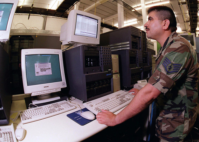 STAFF Sergeant Oscar Llamas, a communication network manager from the 48th Communication Squadron (CS), 48th Fighter Wing, Royal Air Force Base Lakenheath, United Kingdom, administers an account on the local mail exchange server at the 48th CS Server Farm. (Duplicate image, see also DF-SD-01-01815 or search 000817-F-9032T-001)