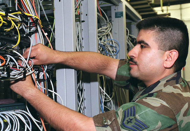 STAFF Sergeant Oscar Llamas, Communication Network Manager from the 48th Communications Squadron, 48th Fighter Wing, Royal Air Force Base Lakenheath, United Kingdom, performs a routine local area network server connectivity check