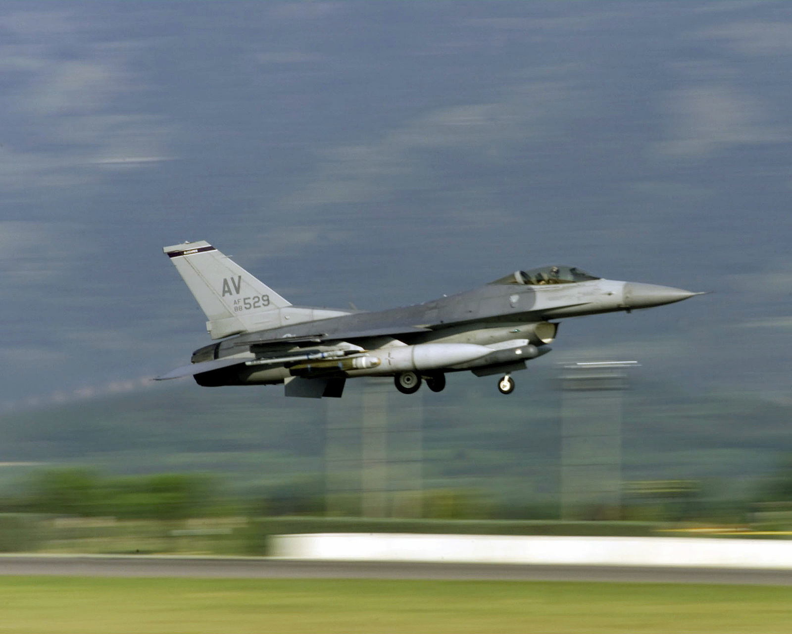 Right side profile medium shot as a US Air Force F-16 Falcon from the 510th Fighter Squadron, 31st Fighter Wing, Aviano Air Base, Italy, launches in Support of Operation Joint Guardian, over the Bosnian continent