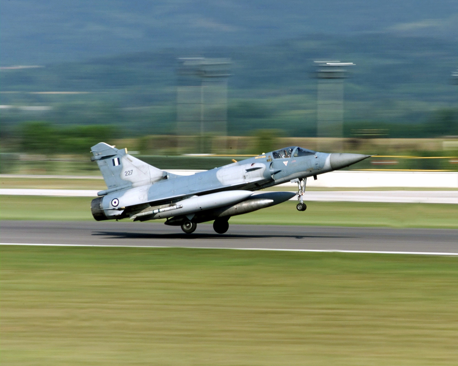 Right side profile medium shot of a Hellenic (Greek) Air Force Mirage 2000 as it rotates out of Aviano Air Base and returns to Greece after an intense week of training with the 510th Fighter Squadron, Aviano Air Base, Italy. (Duplicate image, see also DF-SD-01-06178 or search 000818-F-4728F-002)