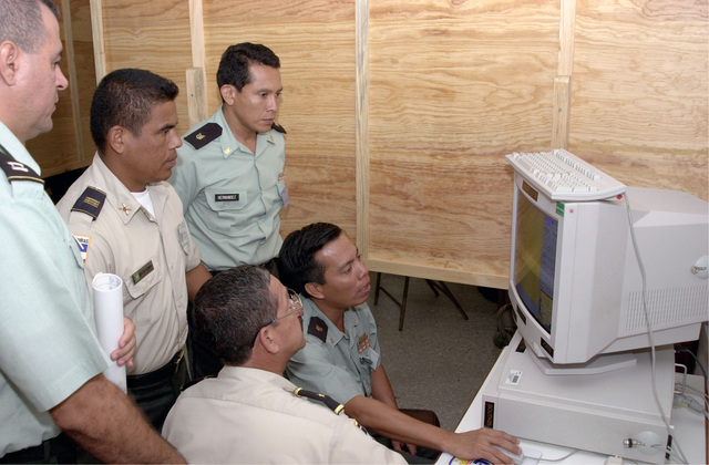 US and Honduran participants work with computer systems during Peace Keeping Operations North 2000, held at the Honduran Military Academy in Tegucigalpa, Honduras, Central America. The exercise runs through 14-25 August 2000, sponsored by US Southern Command in Miami, Florida, and executed by US Army South in Ft. Buchanan, Puerto Rico