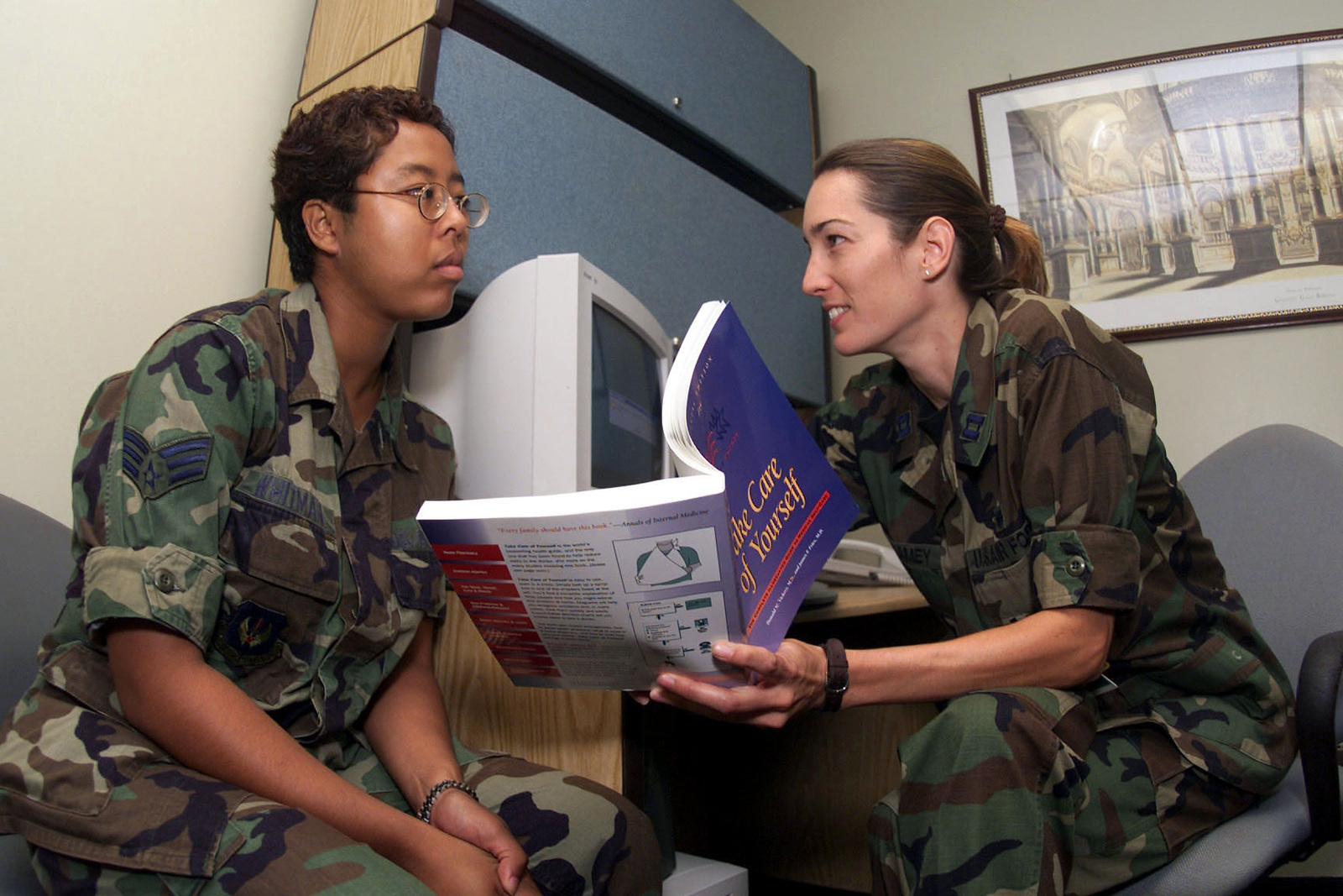 A Triage Nurse, Captain Jennifer McKaney, 31st Medical Group Aviano Air Base, Italy, gives SENIOR AIRMAN Laschelle Whitman information on home remedies for common ailments. The Triage Nurse at Aviano helps patients at the hospital and gives phone consultations