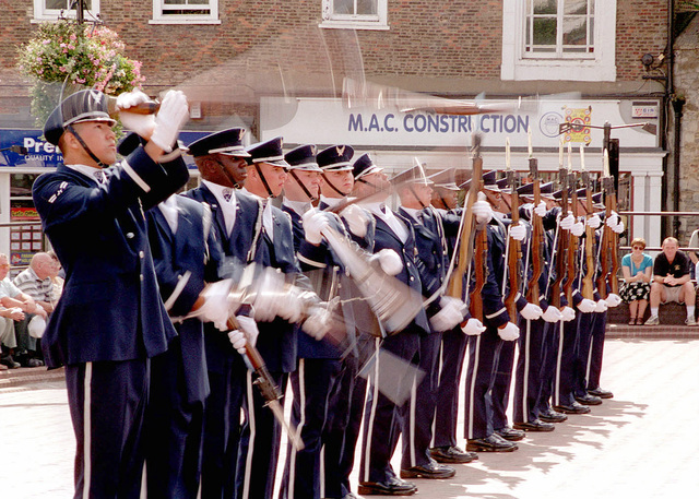 Members of the United States Air Force Honor Guard Precision Drill Team, 11th Wing at Bolling Air Force Base, Washington, D.C., spin their M-1 Garand rifles, with bayonets attached, during an exhibition for the residents of Ely, England. This was the first time the team performed for a British crowd. (Duplicate image, see also DF-SD-01-07659 or search 000824-F-4177H-005)