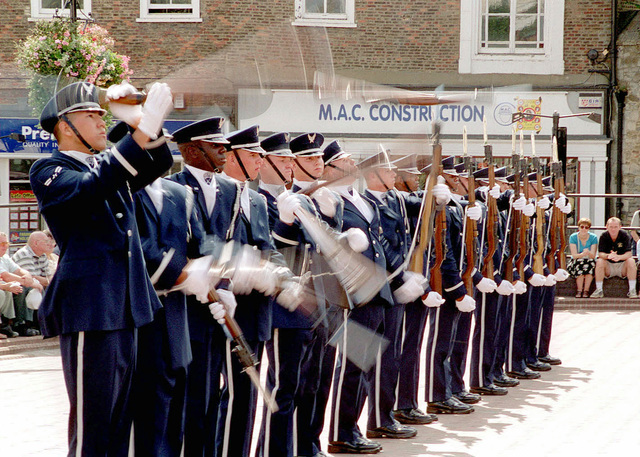 Members of the United States Air Force Honor Guard Precision Drill Team, 11th Wing at Bolling Air Force Base, District of Columbia, spin their M-1 Garand rifles during an exhibition for the residents of Ely, England. This was the first time the team performed for a British crowd. (Duplicate image, see also DF-SD-01-03268 or search 000824-F-4177H-005)