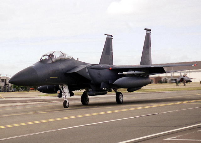 A US Air Force F-15E Strike Eagle from the 492nd Fighter Squadron, 48th Fighter Wing, Royal Air Force Lakenheath, United Kingdom, rolls down the taxiway. The Strike Eagle is a two-seat fighter designed to maintain air superiority during combat. (Duplicate image, see also DF-SD-01-03274 or search 000828-F-9032T-002)
