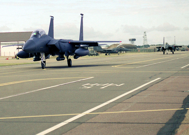 US Air Force F-15E Strike Eagles from the 492nd Fighter Squadron, 48th Fighter Wing, Royal Air Force Lakenheath, United Kingdom, roll down the taxiway prior to launch. The Strike Eagle is a two-seat fighter designed to maintain air superiority during combat. (Duplicate image, see also DF-SD-01-03275 or search 000828-F-9032T-003)